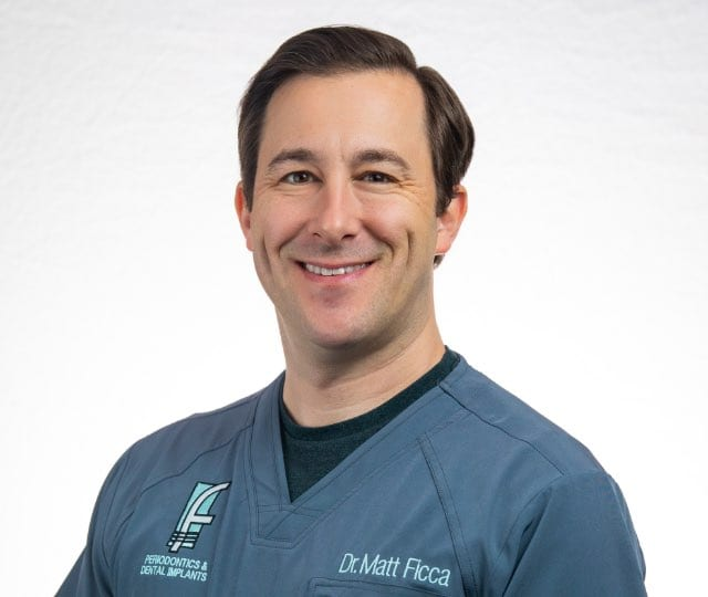 Headshot of Dr. Ficca in medical scrubs