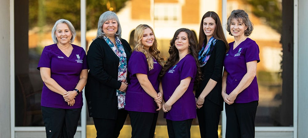 A group photo of the Metrolina Periodontics dental staff