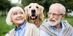 Smiling Old Couple with a Dog in Between