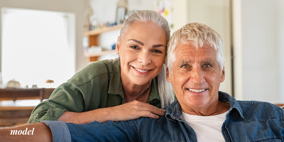 Older Couple Sitting at Home Smiling
