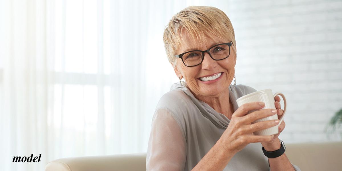 Older Female With Dentures Drinking from Mug